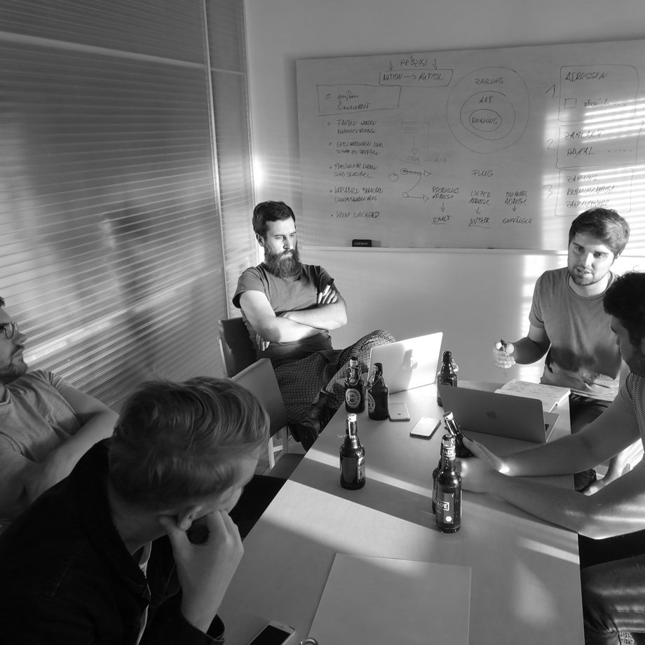 Black and white photo of an internal workshop in the meeting room of DUMBO